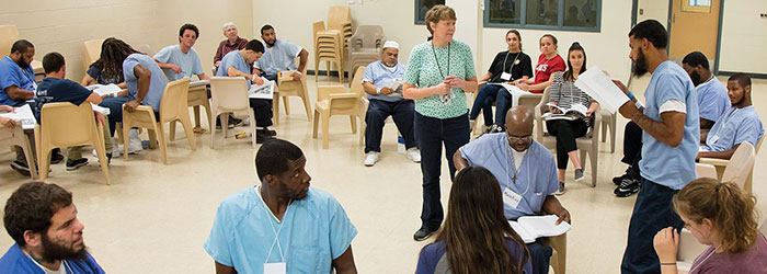 Large-group discussions—like this one among a mixed group of incarcerated and non-imprisoned students at the minimum-security Cambria Community Center—create unique learning opportunities for both populations.
