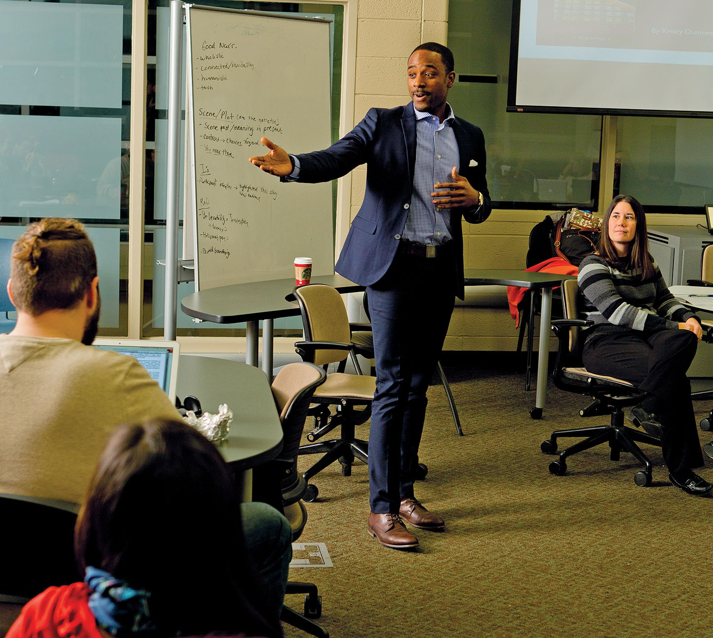 In-class presentations are now routine events for Range, who earned his bachelor's degree at Wilberforce University and a master's degree in higher education policy and organizational leadership at the University of Illinois. Here, he participates in a graduate-level class in education research at Michigan State.