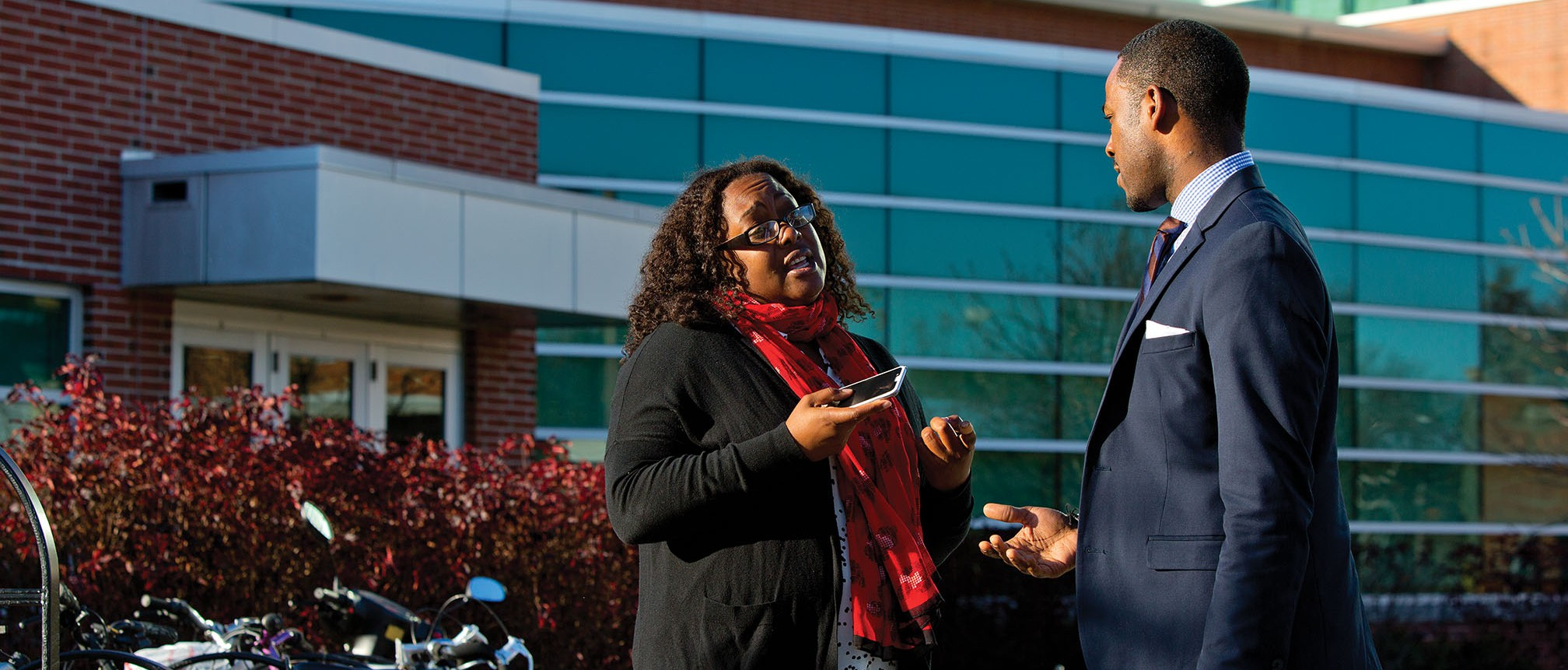 Range confers with Qiana Green, a doctoral student in the Higher, Adult and Lifelong Education program at Michigan State. Green has been a mentor and friend to Range since his arrival on the East Lansing campus.