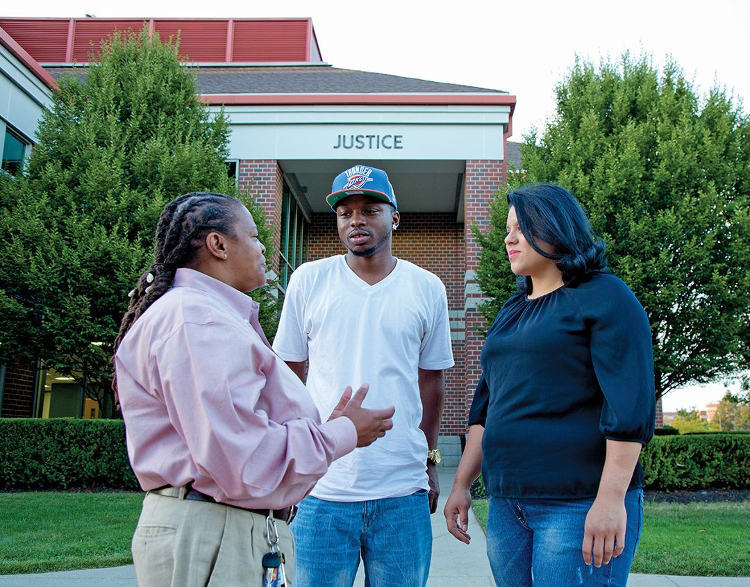 """College Unbound Case Manager Wanda Brown (left) talks with Keila Fiorentino (right) and Marquese Jones, who was introduced to the Bridge Program shortly before his release in April. """"Coming home with a felony, I knew the best thing to do was get an education,"""" says Jones, adding that Brown has been instrumental in keeping him focused on that goal."""