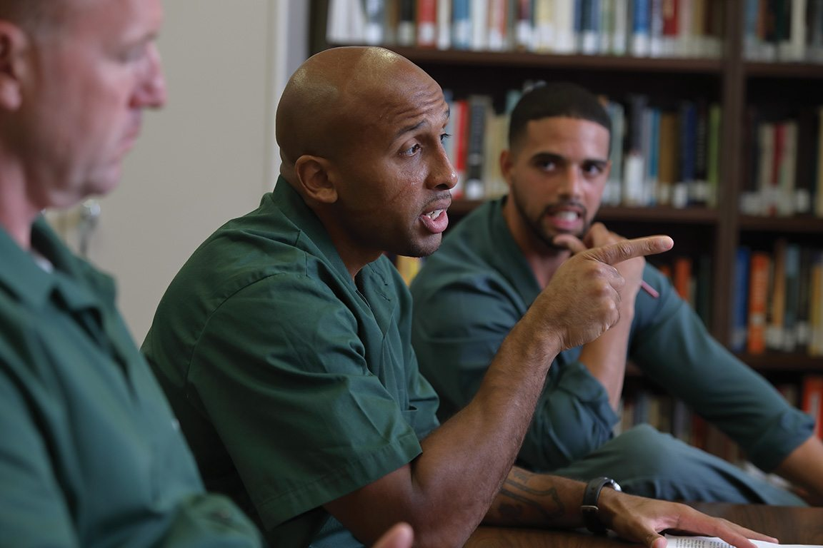 """Inmate Alelur """"Alex"""" Duran makes a point to his Bard classmates at Eastern Correctional Facility, including Jonathan Alvarez (right). Duran, who has spent 12 of his 32 years behind bars and is up for parole in November, has made the most of his time in prison. He earned his GED, enrolled in college, and competed on a headline-grabbing debate team."""