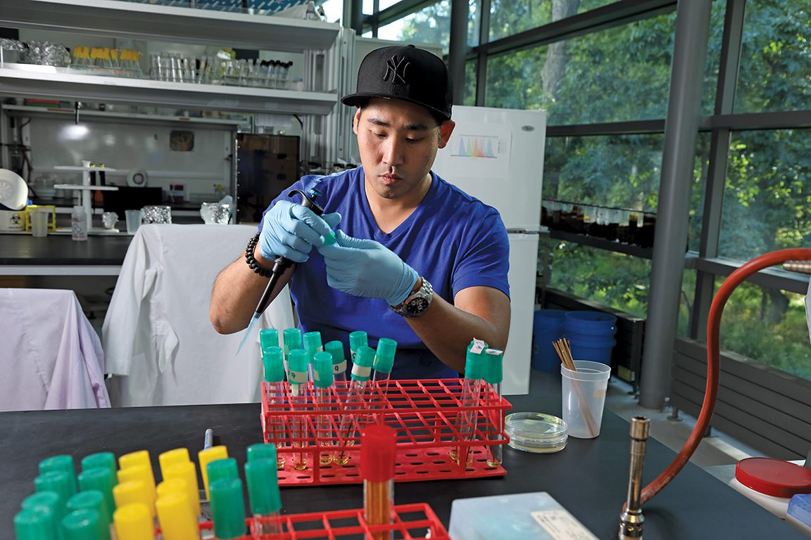 Paul Kim, a BPI student who was imprisoned for 17 of his 35 years, is now out on parole, finishing up his senior chemistry project. Here he works in a Bard College biotech lab, doing interspecies comparative genetics research.