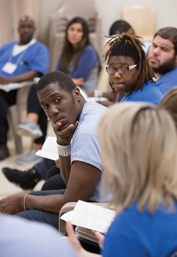 "During Inside-Out classes, incarcerated students and those who visit from the ""outside"" purposefully sit side by side to encourage productive interaction. Here, inmate Omar sits to the left of Yaa, a senior at St. Joseph's University. (To comply with corrections department policy, all participants are identified by first name only.)"