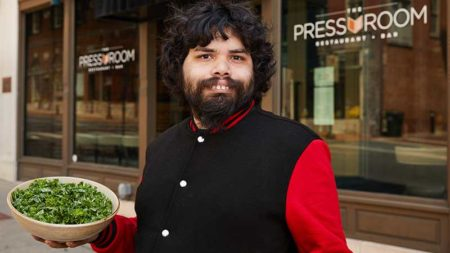 Daniel Castellanos shows off his signature salad outside The Pressroom restaurant in Lancaster, Pennsylvania.