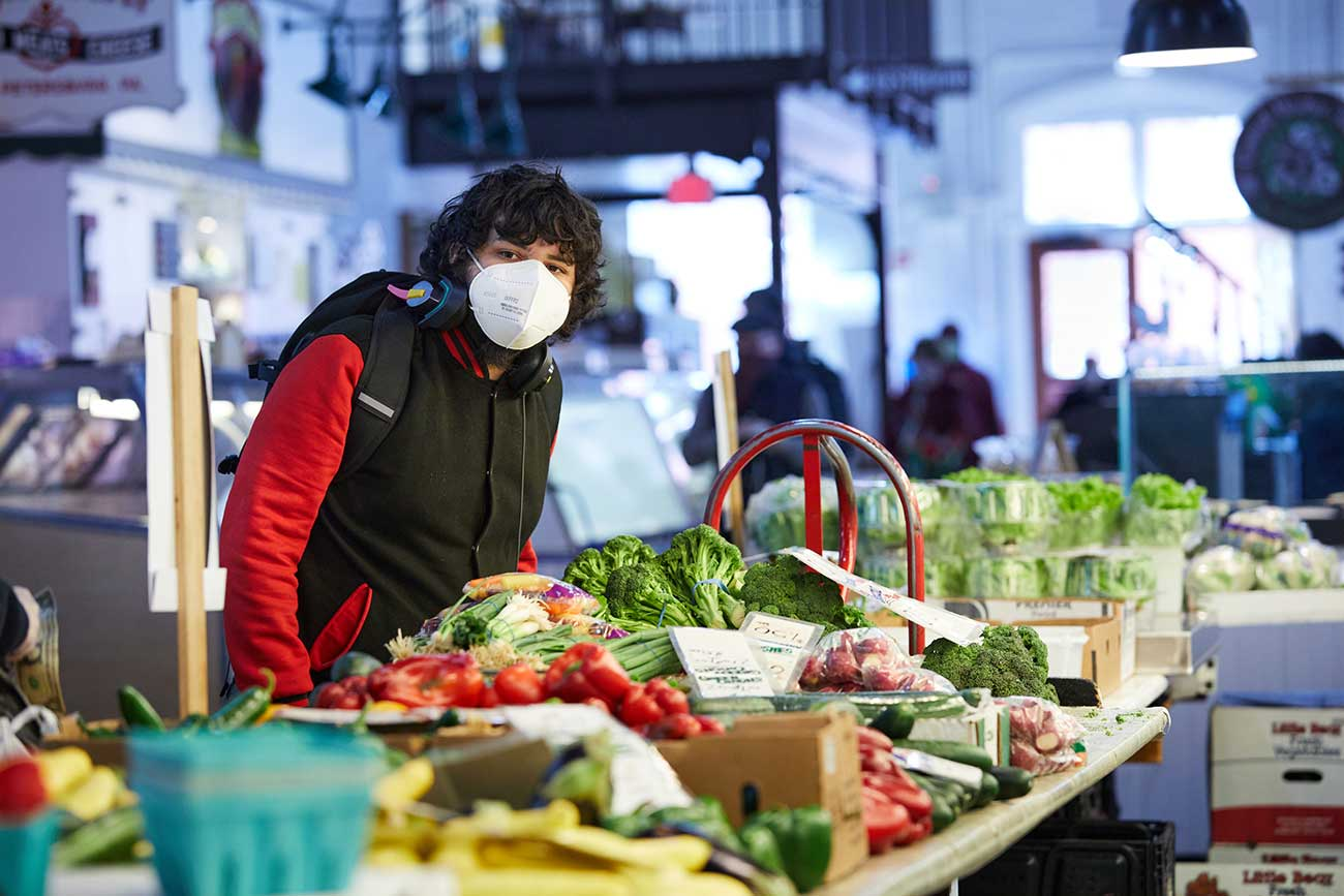 Daniel Castellanos shoping for fresh produce at Lancaster's Central Market.