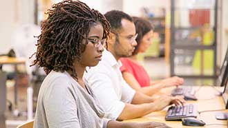 Stock photo: students at row of computers working independently