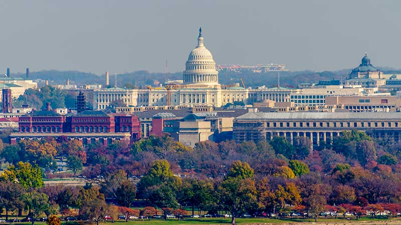 The United States Capitol can be seen from Arlington National Cemetery here on a beautiful fall day in Washington D.C.
