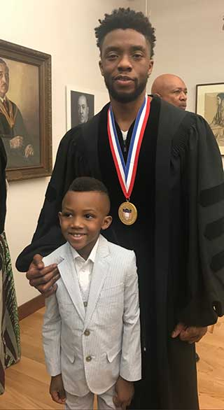 Boseman pictured with the author's son, William Howard Jr.