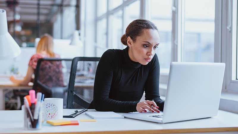 Black female IT worker, stock photo.
