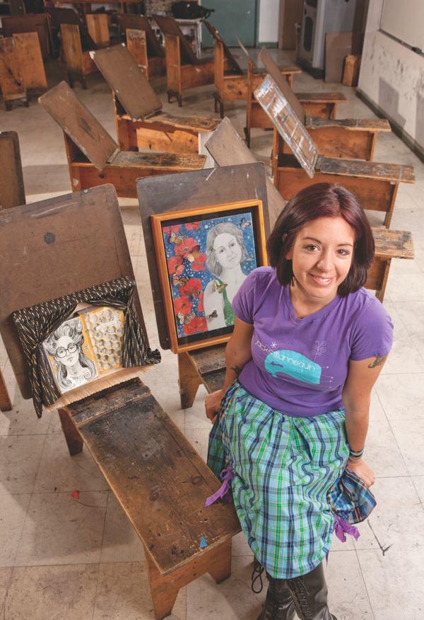 Fine arts major Christobel Torres displays some of her work.