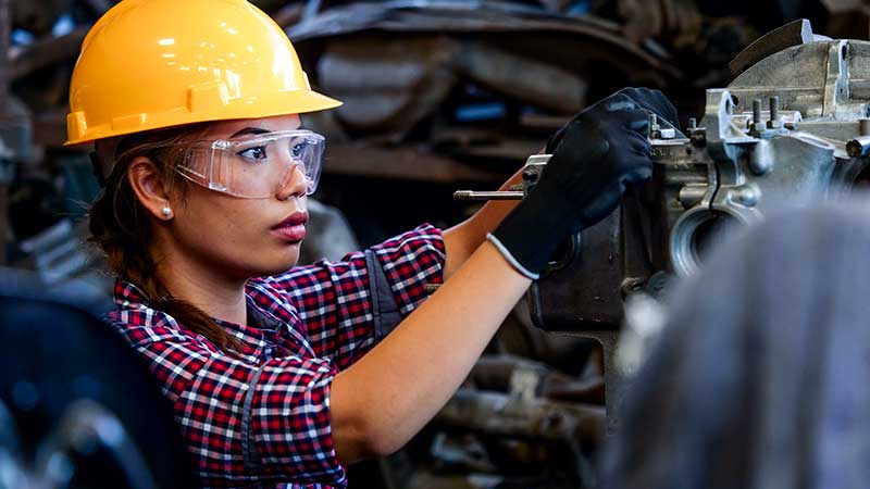 Female factory worker, stock photo.
