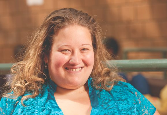 Smiling photo of Marisa Klages, an associate professor of English and the director of assessment at LaGuardia Community College.