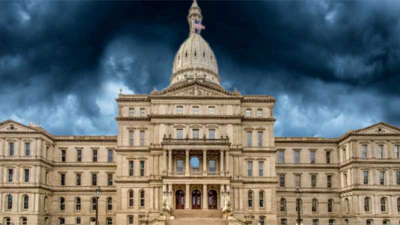 State capitol building with storm clouds in the background.