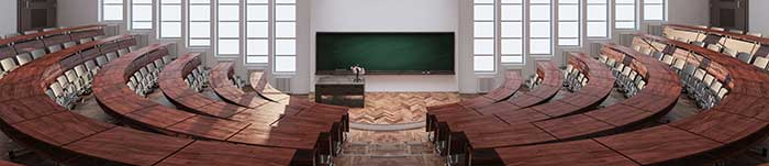 A wide shot of an empty college classroom.