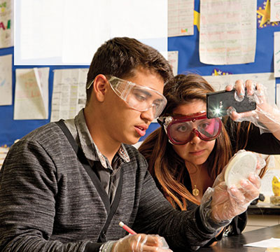 Fabien Cuen and Adriana Herrera work on a science experiment as part of the Anteater Academy program at Valley High School in Santa Ana, Calif.
