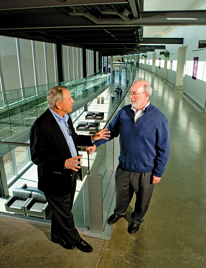 """Hutch Schumaker (left) is the board chairman for the Columbus Community Education Coalition, and John Burnett serves as its CEO. Burnett, a former executive with Cummins Inc., says the Coalition is successful because the spirit of collaboration is """"in our DNA."""