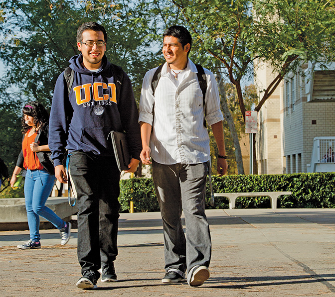 """Juan Carlos Alcocer (left) and Rodrigo Marcos Ramirez are now students at UC-Irvine, but neither of them could see a clear path to college during their younger years. The Santa Ana Partnership helped clear the path for both. """"Nobody in my family ever graduated from high school,"""" Alcocer says, """"but I jumped through all these obstacles, and here I am."""""""