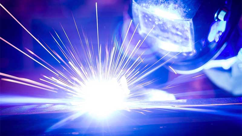 This photo shows a man welding.