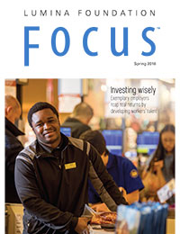 Cover of Focus magazine depicts Ali Hassan of Wegmen's work scholarship program at work in a grocery store environment.