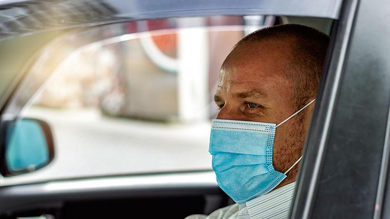 Cab driver in a covid mask.