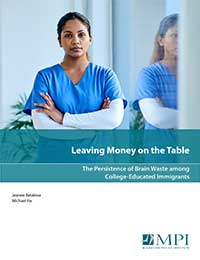 report cover image shows a young woman of color in scrubs with her arms folded.