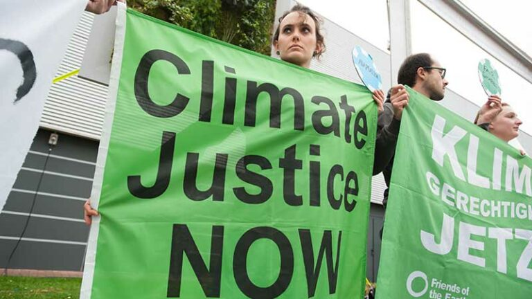 Climate activists at the COP21 UN climate summit in Paris, France, stage a protest calling for